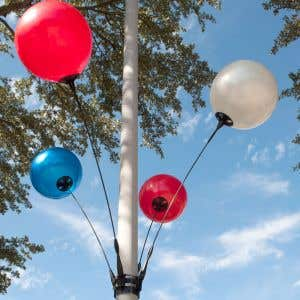 Light pole balloons make you parking lot stand out.